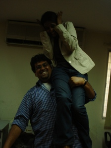 This is me posing as superman. I am quite strong. My colleague, who's sitting on my shoulder, weighs a little less than 61 kilos. I did not drop her.